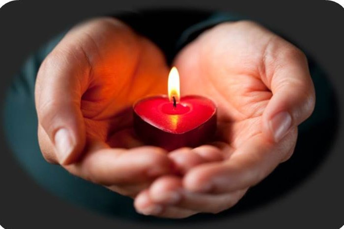 heart-candle-in-hands.jpg