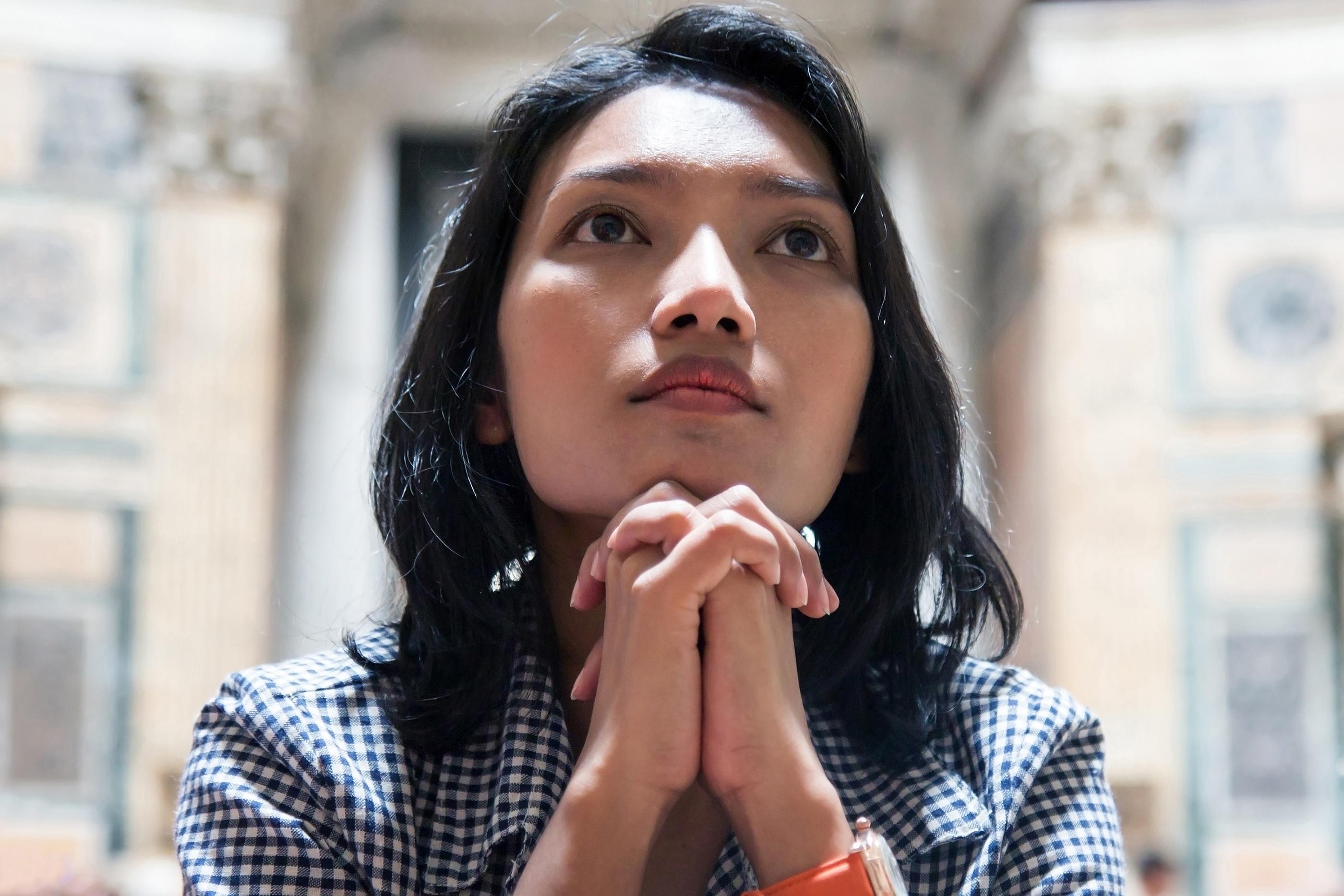 woman reflecting and prayer